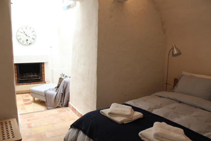 Second bedroom looking toward open fireplace